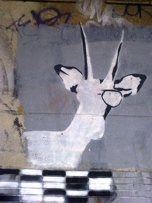 Graffiti na dnes již neexistujícím opuštěném objektu v areálu Klánovického nádraží<br />  Foto: Zuzana Ottová
